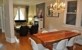 Leslieville house dining room, open concept with hardwood flooring and chandelier